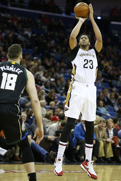 New Orleans Pelicans forward Anthony Davis (23) shoots over Milwaukee Bucks center Miles Plumlee (18) during the second half of an NBA basketball game Saturday, Jan. 23, 2016, in New Orleans. The Pelicans won 116-99. (AP Photo/Jonathan Bachman)