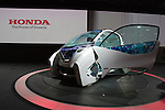 """December 30, 2011, Tokyo, Japan - Honda Motor Co.'s """"Micro Commuter"""" concept car is displayed during the 42nd Tokyo Motor Show. The show opens to the general public from December 3-11. (Photo by Christopher Jue/AFLO)"""