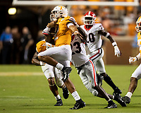 KNOXVILLE, TN - OCTOBER 5: Jarrett Guarantano #2 of the Tennessee Volunteers is tackled by Mark Webb #23 of the Georgia Bulldogs during a game between University of Georgia Bulldogs and University of Tennessee Volunteers at Neyland Stadium on October 5, 2019 in Knoxville, Tennessee.