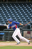 Jose Almonte #5 of the AZL Rangers bats against the AZL Cubs at Surprise Stadium on July 6, 2014 in Surprise, Arizona. AZL Rangers defeated the AZL Cubs, 7-5. (Larry Goren/Four Seam Images)