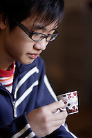 2006 Model Release Photo -<br /> 14 year old chinese teenager drinking espresso coffee.