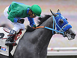 August 8, 2011. Rafael Bejarano riding Creative Cause gives a clenched fist as he approaches the finish line and wins the Best Pal Stakes at the Del Mar Thoroughbred Club, Del Mar, CA