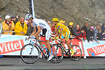 White Jersey Andy Schleck (LUX) Saxo Bank takes the stage win with Yellow Jersey Alberto Contador (ESP) Astana behind at the summit finish of the Col du Tourmalet during a wet foggy Stage 17 of the 2010 Tour de France running 174km from Pau to Col du Tourmalet, France. 22nd July 2010.<br /> (Photo by Eoin Clarke/NEWSFILE).<br /> All photos usage must carry mandatory copyright credit (© NEWSFILE | Eoin Clarke)