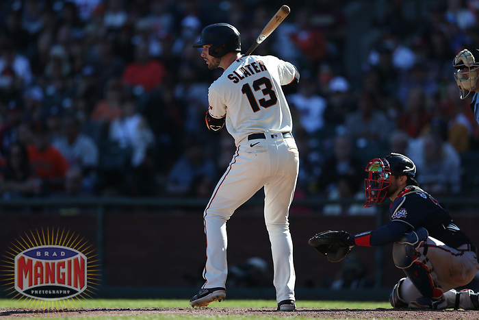 SAN FRANCISCO, CA - SEPTEMBER 19:  Austin Slater #13 of the San Francisco Giants bats against the Atlanta Braves during the game at Oracle Park on Sunday, September 19, 2021 in San Francisco, California. (Photo by Brad Mangin)