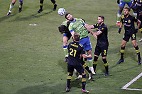 COLUMBUS, OH - DECEMBER 12: Will Bruin #17 of the Seattle Sounders FC heads the ball during a game between Seattle Sounders FC and Columbus Crew at MAPFRE Stadium on December 12, 2020 in Columbus, Ohio.