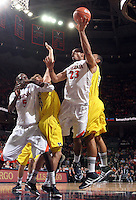 CHARLOTTESVILLE, VA- NOVEMBER 29: Mike Scott #23 of the Virginia Cavaliers shoots the ball with Michigan Wolverine defenders during the game on November 29, 2011 at the John Paul Jones Arena in Charlottesville, Virginia. Virginia defeated Michigan 70-58. (Photo by Andrew Shurtleff/Getty Images) *** Local Caption *** Mike Scott