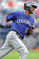 Colorado Rockies center fielder Dexter Fowler #24 runs to first during a game against the Atlanta Braves at Turner Field on September 3, 2012 in Atlanta, Georgia. The Braves  defeated the Rockies 6-1. (Tony Farlow/Four Seam Images).