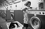 Public Laundry 1970s UK . Women taking their dirty used clothes to a public laundry to get them washed. Battersea south London 1979