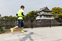 A man runs past the Imperial Palace in Tokyo.