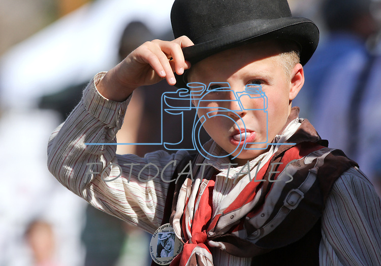 """Taylor Lively, 7, whose gunslinger name is """"El Dorado Johnny,"""" blows bubbles while watching the Dayton Valley Days parade in Dayton, Nev., on Saturday, Sept. 18, 2010..Photo by Cathleen Allison"""