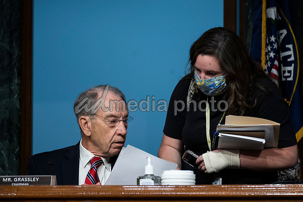"United States Senator Chuck Grassley (Republican of Iowa) speaks with an aide during a United States Senate Finance Committee hearing on ""COVID-19 and Beyond: Oversight of the FDA's Foreign Drug Manufacturing Inspection Process"" at the US Capitol in Washington, DC on June 2, 2020.<br /> Credit: Andrew Caballero-Reynolds / Pool via CNP/AdMedia"