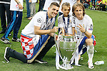 Real Madrid's Mateo Kovacic (l) and Luka Modric celebrate the victory in the UEFA Champions League 2015/2016 Final match.May 28,2016. (ALTERPHOTOS/Acero)