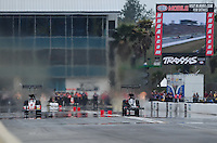 Mar. 10, 2012; Gainesville, FL, USA; NHRA top fuel dragster driver David Grubnic (left) races alongside Brady Kalivoda during qualifying for the Gatornationals at Auto Plus Raceway at Gainesville. Mandatory Credit: Mark J. Rebilas-