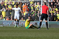 Pictured: Robert Snodgrass of Norwich on the ground, referee Michael Oliver (R) points to a free kick. Saturday 06 April 2013<br /> Re: Barclay's Premier League, Norwich City FC v Swansea City FC at the Carrow Road Stadium, Norwich, England.