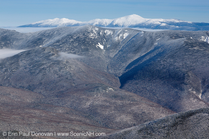 Scenic view from the summit of Mount Lafayette during the winter months in the White Mountains, New Hampshire USA. Mount Washington is off in the distance.