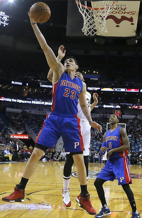 Detroit Pistons forward Ersan Ilyasova (23) rebounds the ball over New Orleans Pelicans forward Anthony Davis, behind, during the first half of an NBA basketball game Thursday, Jan. 21, 2016, in New Orleans. (AP Photo/Jonathan Bachman)