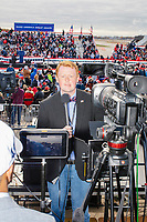 Alex Caldwell, a commentator on the rightwing Right Side Broadcasting Network, prepares to broadcast from the press riser before the arrival of US President Donald Trump at a Make America Great Again Victory Rally in the final week before the Nov. 3 election at Pro Star Aviation in Londonderry, New Hampshire, on Sun., Oct. 25, 2020. Right Side Broadcasting Network is an online network devoted to showing full-length Trump campaign rallies.