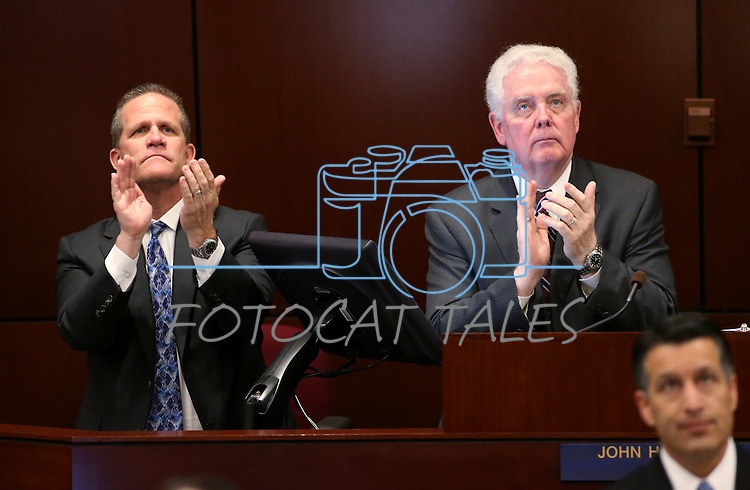 Lt. Gov. Mark Hutchison, left, and Assembly Speaker-elect John Hambrick, R-Las Vegas, acknowledge people in the crowd during Gov. Brian Sandoval's State of the State address at the Legislative Building in Carson City, Nev., on Thursday night, Jan. 15, 2015. (Las Vegas Review-Journal/Cathleen Allison)