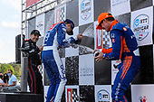 #10: Alex Palou, Chip Ganassi Racing Honda, #12: Will Power, Team Penske Chevrolet, #9: Scott Dixon, Chip Ganassi Racing Honda celebrate with champagne in victory lane