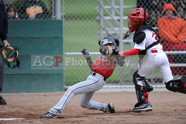 The Major Diamondbacks play on opening day in Pleasanton National Little League  March 14, 2009.