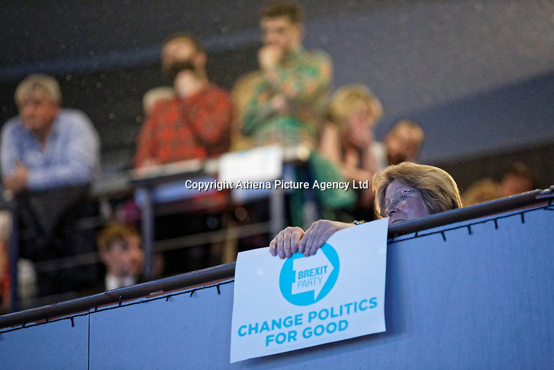 Pictured: A supporter holds a placard on the balcony of the venue. Tuesday 30 April 2019<br /> Re: Nigel Farage and Anne Widdecombe at the Brexit Party rally at The Neon in Clarence Place in Newport, south Wales, UK.
