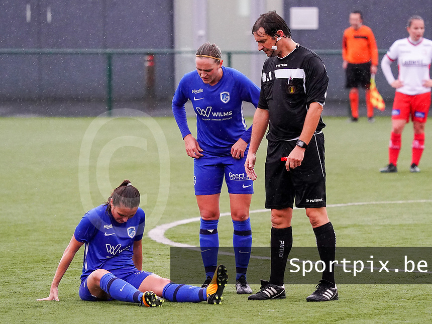 Match referee Andy De Ketelaere  and Genk's Dorien Groven (4) checks with the injured player Genk's Kayleigh Rigo (16) during a female soccer game between the women teams of Zulte Waregem A Dames and KRC Genk Ladies B on the 1/16 th qualifying round for the Belgian Womens Cup 2020  2021 , on saturday 26 th of September 2020  in Zulte , Belgium . PHOTO SPORTPIX.BE | SPP | SEVIL OKTEM