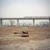 An empty sofa stands at a village which has been demolished for a new train line on the outskirts of Beijing, China in January, 2011. (Mamiya 6, 75mm f3.5, Kodak Ektar 100 film)