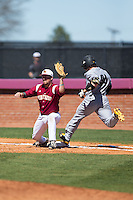 Winthrop Eagles first baseman Mark Lowrie (15) stretches for a throw as Griffin Helms (34) of the Kennesaw State Owls runs through the bag at the Winthrop Ballpark on March 15, 2015 in Rock Hill, South Carolina.  The Eagles defeated the Owls 11-4.  (Brian Westerholt/Four Seam Images)