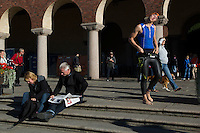 25 AUG 2013 - STOCKHOLM, SWE - A competitor stretches as he waits for his wave start of the Stockholm Triathlon in front of Stockholm City Hall, Stockholm, Sweden (PHOTO COPYRIGHT © 2013 NIGEL FARROW, ALL RIGHTS RESERVED)
