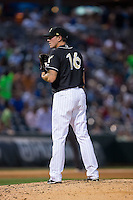 Charlotte Knights starting pitcher Chris Beck (16) looks to his catcher for the sign against the Louisville Bats at BB&T BallPark on May 12, 2015 in Charlotte, North Carolina.  The Knights defeated the Bats 4-0.  (Brian Westerholt/Four Seam Images)