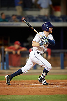 Charlotte Stone Crabs first baseman Dalton Kelly (7) follows through on a swing during a game against the Palm Beach Cardinals on April 11, 2017 at Charlotte Sports Park in Port Charlotte, Florida.  Palm Beach defeated Charlotte 12-6.  (Mike Janes/Four Seam Images)