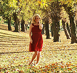 Portrait of a young woman in a park