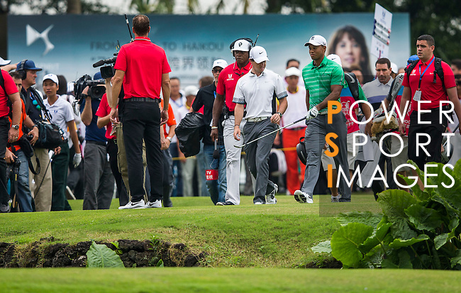 Tiger Woods and Rory McIlroy in action during 'The Match' golf duel on the Blackstone Course on October 28, 2013 at Mission Hills Golf Club in Haikou, China. Photo by Jerome Favre / The Power of Sport Images