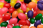 close up of colorful jelly beans on shadowless white background