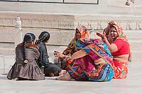 Agra, India.  Taj Mahal.  Indian Women Wearing Saris Sitting and Talking.  Note the ankle bracelet.