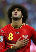 Marouane Fellaini of Belgium looks to the sky as he sings his national anthem