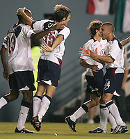 USA's Chris Armas celebrates after Eddie Pope scores to lead the USA past Mexico 1-0, in Dallas, Texas, 4/28/04.