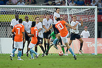 Netherlands forward (10) Gerald Sibon hits a free kick that goes under the wall for a goal while playing at Tianjin Olympic Centre Stadium. The USMNT tied the Netherlands, 2-2, during the 2008 Beijing Olympics in Tianjin, China.