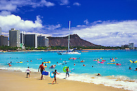 Diamond Head crater and Waikiki Beach entice visitors from around the world.