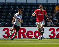 18th July 2021; Pride Park, Derby, East Midlands; Pre Season Friendly Football, Derby County versus Manchester United;  Mason Greenwood of Manchester United tracked by Graeme Shinnie of Derby County