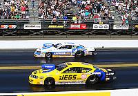 Jul. 28, 2013; Sonoma, CA, USA: NHRA pro stock driver Jeg Coughlin (near lane) races alongside Allen Johnson during the Sonoma Nationals at Sonoma Raceway. Mandatory Credit: Mark J. Rebilas-