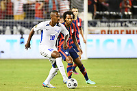 KANSAS CITY, KS - JULY 15: Kevin Fortune #10 Martinique with the ball during a game between Martinique and USMNT at Children's Mercy Park on July 15, 2021 in Kansas City, Kansas.