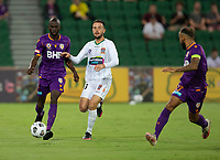 27th March 2021; HBF Park, Perth, Western Australia, Australia; A League Football, Perth Glory versus Newcastle Jets; Jason Geria of the Perth Glory passes to Diego Castro as Apostolos Stamatelopoulos of the Newcastle Jets moves in to tackle