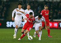SWANSEA, WALES - MARCH 16: Jack Cork of Swansea (R) is challenged by Philippe Coutinho of Liverpool (L) during the Premier League match between Swansea City and Liverpool at the Liberty Stadium on March 16, 2015 in Swansea, Wales