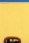 Red volkswagon in front of a yellow wall along street Ballard Seattle Washington State USA