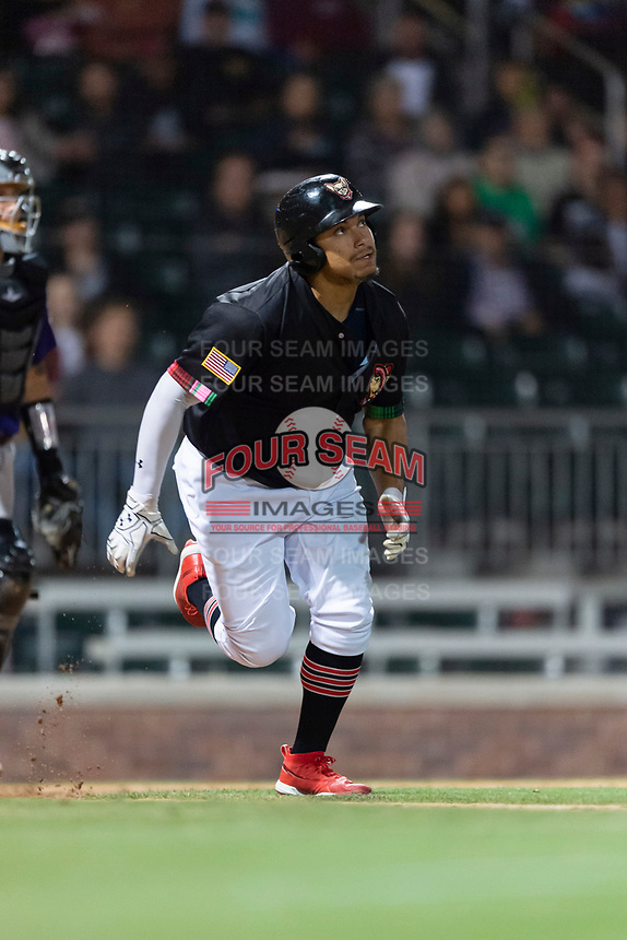 El Paso Chihuahuas right fielder Josh Naylor (27) jogs towards first base during a Pacific Coast League game against the Albuquerque Isotopes at Southwest University Park on May 10, 2019 in El Paso, Texas. Albuquerque defeated El Paso 2-1. (Zachary Lucy/Four Seam Images)