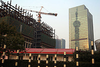 CHINA. Shanghai. Construction in the Pudong area of Shanghai. Shanghai is a sprawling metropolis or 15 million people situated in south-east China. It is regarded as the country's showcase in development and modernity in modern China. This rapid development and modernization, never seen before on such a scale has however spawned countless environmental and social problems. 2008.
