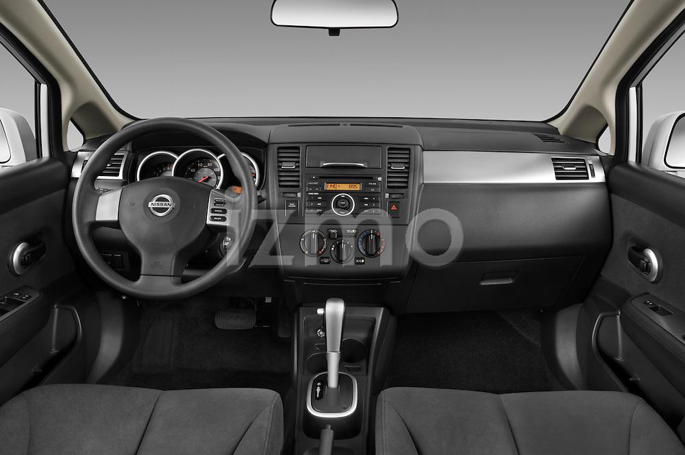 Straight dashboard view of a 2009 Nissan Versa Hatchback.