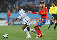 Honduran forward David Suazo directs pay in front of Spanish defender Gerard Pique. Spain defeated Honduras, 2-0, in their second match of play in Group H  in a match played Monday, June 21st, at Ellis Park in Johannesburg, South Africa at the 2010 FIFA World Cup..