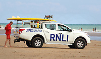 RNLI Lifeguards patrol the popularbeach at Camber Sands in Sussex. After several deaths in waters off the beach4 years ago, Lifeguards were installed at the central Camber beach a couple of years ago. Up to 25,000 people can be on the huge sandy beach at the peak of the season with it's mass of sand dunes adding to the attraction. Camber Sands, Sussex on September 1st 2020<br /> <br /> Photo by Keith Mayhew